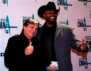 (AP Photo/Chitose Suzuki, File). FILE - In this Nov. 6, 2006 file photo, Phil Everly, left, and Cowboy Troy arrive at the 40th Annual CMA Awards in Nashville, Tenn.