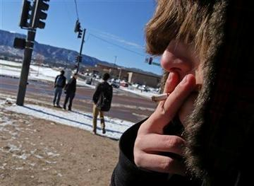 (AP Photo/Brennan Linsley). A high school student, who pre