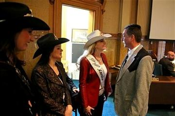 ( AP Photo/Brennan Linsley). In this Jan. 22, 2014 photo, Colorado state representative Jerry Sonnenberg (R-Sterling) talks with Miss Rodeo America Paige Nicholson, inside the chambers of the Colorado State Legislature, at the Capitol, in Denver.