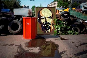 (AP Photo/Alexander Zemlianichenko). A portrait of Bolshevik leader Vladimir Lenin is set into a barricade in the center of  Slovyansk, eastern Ukraine, Saturday, May 3, 2014.