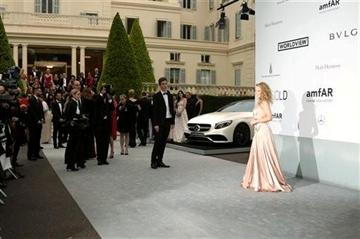 (Photo by Joel Ryan/Invision/AP). Singer Kylie Minogue arrives at the amfAR Cinema Against AIDS benefit at the Hotel du Cap-Eden-Roc, during the 67th international film festival, in Cap d'Antibes, southern France, Thursday, May 22, 2014.