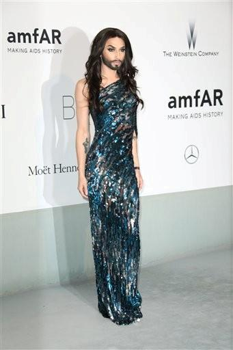 (Photo by Joel Ryan/Invision/AP). Singer Conchita Wurst arrives at the amfAR Cinema Against AIDS benefit at the Hotel du Cap-Eden-Roc, during the 67th international film festival, in Cap d'Antibes, southern France, Thursday, May 22, 2014.