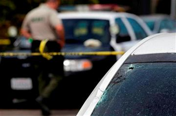 (AP Photo/Jae C. Hong). This photo shows the windshield of a car that was shattered by a bullet at the scene of a shooting on Saturday, May 24, 2014, in Isla Vista, Calif.