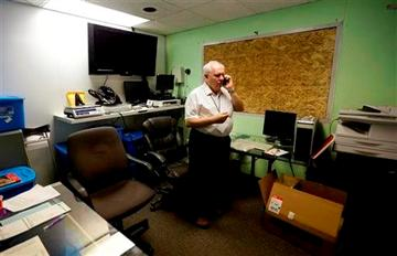 (AP Photo/Ted S. Warren). In this June 25, 2014, photo, Bob Leeds, owner of Sea of Green Farms, a recreational pot grower and processor in Seattle, talks on the phone in his office.