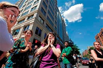 (AP Photo/J. Scott Applewhite, File). FILE - This Aug. 23, 2011 file photo shows office workers gathering on the sidewalk in downtown Washington after a 5.9 magnitude tremor shook the nation's capitol.