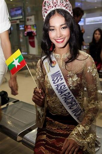 (AP Photo/Khin Maung Win). FILE - In this June 5, 2014 file photo, Myanmar model May Myat Noe, winner of Miss Asia Pacific World 2014 pageant, waves a miniature flag of the country upon her arrival at Yangon International Airport in Yangon, Myanmar.