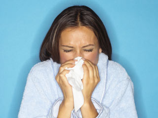 Wind can stir pollen and mold into the air. (©Brand X Pictures/Thinkstock)
