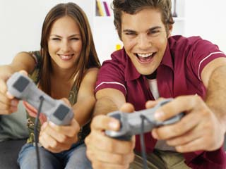 Playing a violent game with a partner changes how people react to violence. (&amp;copy;Stockbyte/Thinkstock)