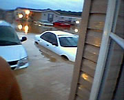 Flood waters rise in Evansville, Indiana, in this July, 2004, photo. If you must to evacuate, turn off utilities, disconnect electrical appliances. Do not touch electrical equipment if you are wet or standing in water.