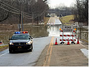Flood waters cover Ohio State Route 39 in the Village of Dellroy. Just two feet of rushing water can carry away most vehicles including sport utility vehicles (SUV's) and pick-ups