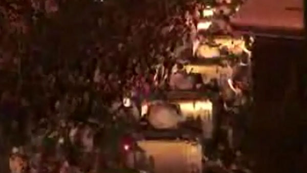 A column of military armored personnel carriers makes its way along a Cairo street Friday. (Source: CNN)