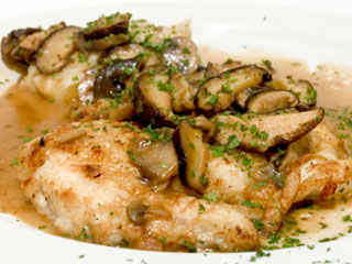 This dish makes chicken special with mushrooms, heavy cream, and champagne. (©iStockphoto.com)