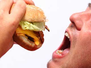 Make sure your guests are not biting into tainted burgers! (©iStockphoto.com/Isabelle Limbach)