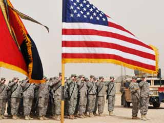 1st Sgt. Jonathan Callahan leads his troops in a salute during a change of command ceremony at Camp Echo, March 21, 2009. (©Army.mil/flickr via creative commons)