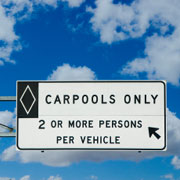 Carpooling is two or more commuters riding in the same vehicle.  This allows you to ride in the commuter lane, if there is one in your area, which will often make your ride to work quicker.  &amp;copy; istockphoto.com/Tim McCaig