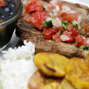 Tostones are a staple in Cuban, Dominican, and Caribbean cooking. They're great with ketchup or hot sauce, like French fries, but with a slightly different flavor. (©iStockphoto.com/Chris Bence)