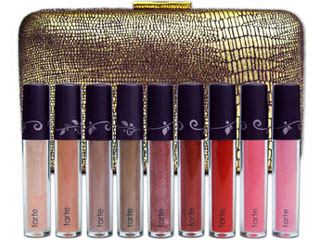 The Tarte, Purse Your Lips Limited Edition Super Fruit Lipgloss Clutch is festive for celebrating the holidays in style. © Tarte