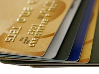 If you are working to pay off a balance, you can save on interest by transferring your balance to a card with 0% interest. (©iStockphoto.com/Christophe Testi)