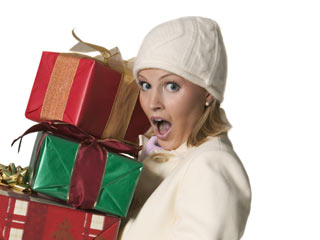 Do you want to buy everyone a present? Yes... but you don't want to be shocked when the bills come in. (&amp;copy;Photodisc/Thinkstock)