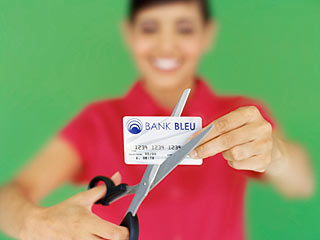 Before you cut up your high interest credit cards you should take these steps. (©George Doyle/ Valueline/Thinkstock)