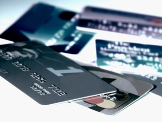 If you're planning to take out a loan for a house or car, hang on to your unused credit lines. (©Medioimages/ Photodisc/Thinkstock)