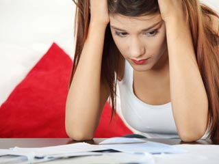 The average American who carries credit card debt owes more than $15,500. (©iStockphoto/Thinkstock)