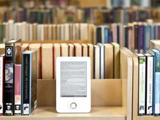 Digital versions of college texts cost less than the paper editions -- until you factor in the cost of the device itself. (©DigitalTrends)