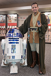 Star Wars fan Chris Bouchard from The Colony, Texas with his limited edition DROID R2-D2 phone. (©PRNewsFoto/Verizon Wireless, Glen E Ellman)
