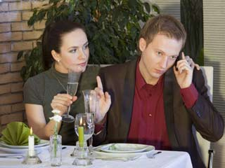 There was a time when visiting a restaurant included having an engaging conversation. (©Hemera/Thinkstock)