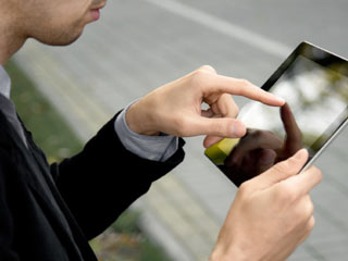 Smartphones and, to some extent, tablets, are blurring the line between our social lives and our work lives. (©iStockphoto/Thinkstock)