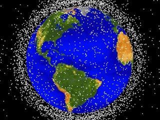 Approximately 95% of the objects in this illustration are orbital debris, i.e., not functional satellites. The dots represent the current location of each item. (© NASA)