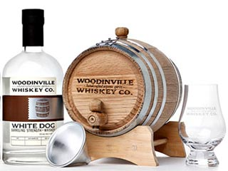 The Age Your Own Whiskey Kit from Woodinville Whiskey Co gives dad the ability to craft his own signature spirit. (Image courtesy of Digital Trends)