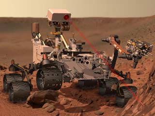 This artist's concept depicts the rover Curiosity as it uses its ChemCam instrument to investigate the composition of a rock surface. (&amp;copy;NASA/JPL-Caltech)