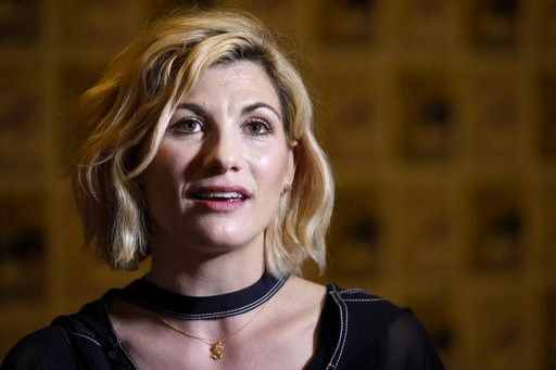 "(Photo by Chris Pizzello/Invision/AP). Jodie Whittaker arrives at the ""Doctor Who"" press line on day one of Comic-Con International on Thursday, July 19, 2018, in San Diego."