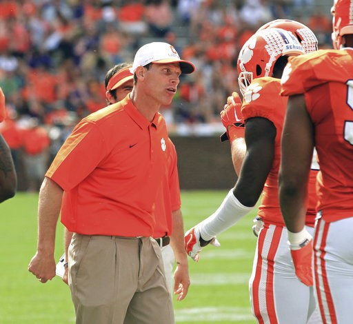(Mark Crammer/Anderson Independent-Mail via AP, File). FILE - In this April 11, 2015, file photo, Clemson defensive coordinator Brent Venables, left, gets on a player during Clemson's NCAA college football spring game at Memorial Stadium in Clemson, S....