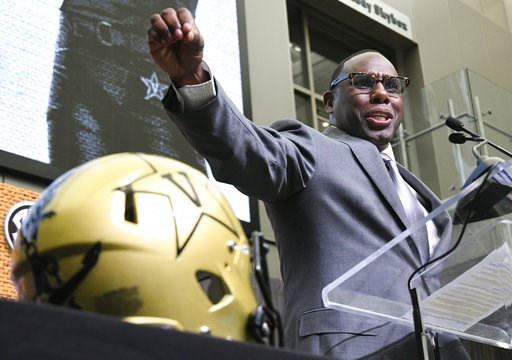 (AP Photo/John Amis). NCAA college football head coach Derek Mason of Vanderbilt speaks during the Southeastern Conference Media Days at the College Football Hall of Fame in Atlanta, Thursday, July 19, 2018.