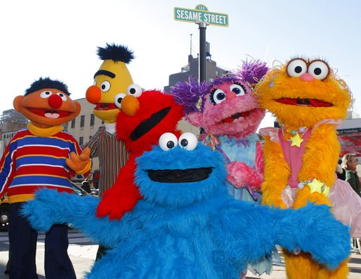 (AP Photo/Kathy Willens, File). FILE - In this Feb. 10, 2010, file photo, characters from Sesame Street Live appear on the street by Madison Square Garden to celebrate the 30th anniversary of the live touring stage shows based on the PBS television ser...