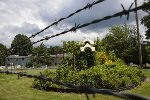 (AP Photo/Matt Rourke). In this Aug. 1, 2018 photo weeds engulf a playground at housing section of the former Naval Air Warfare Center Warminster in Warminster, Pa. In Warminster and surrounding towns in eastern Pennsylvania, and at other sites around ...