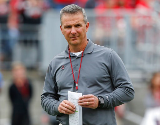 (AP Photo/Jay LaPrete, File). FILE - In this April 14, 2018, file photo, Ohio State coach Urban Meyer watches the NCAA college football team's spring game in Columbus, Ohio. Ohio State has placed Meyer on paid administrative leave while it investigates...