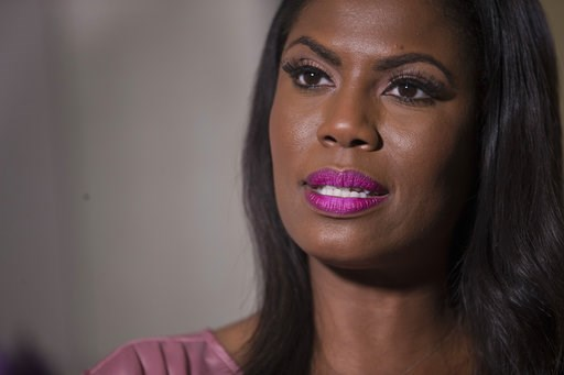 """(AP Photo/Mary Altaffer). Television personality and former White House staffer Omarosa Manigault Newman speaks during an interview with The Associated Press, Tuesday, Aug. 14, 2018, in New York. Manigault Newman declared she """"will not be silenced"""" by ..."""