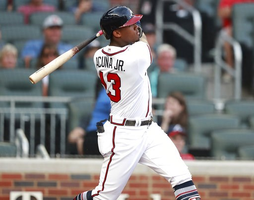 (Curtis Compton/Atlanta Journal-Constitution via AP). Atlanta Braves' Ronald Acuna Jr. hits a lead-off home run in the first inning of a baseball game against the Miami Marlins Tuesday, Aug. 14, 2018 in Atlanta.