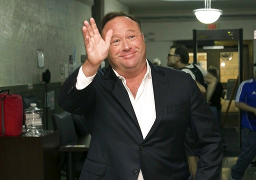 (Jay Janner/Austin American-Statesman via AP, File). FILE - In this April 19, 2017, file photo, Alex Jones, a right-wing radio host and conspiracy theorist, arrives at the courthouse in Austin, Texas. Twitter says it is suspending the account of the fa...