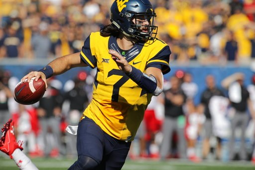 (AP Photo/Raymond Thompson, File). FILE - In this Oct. 14, 2017, file photo, West Virginia quarterback Will Grier (7) looks to pass against Texas Tech during an NCAA college football game in Morgantown, W.Va. While the Sooners are still the preseason f...