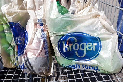 (AP Photo/Rogelio V. Solis, File). FILE- This June 15, 2017, file photo shows bagged purchases from the Kroger grocery store in Flowood, Miss. Kroger Co. has chosen a Phoenix suburb as the launching pad for delivering groceries to doorsteps using drive...