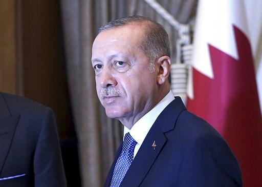 (Presidential Press Service via AP, Pool). Turkey's President Recep Tayyip Erdogan, as he shakes hands with Qatar's Emir Sheikh Tamim bin Hamad Al Thani prior to their talks at the Presidential Palace in Ankara, Turkey, Wednesday, Aug. 15, 2018. Turkey...