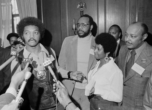 (AP Photo/Jim Wells, File). This March 26, 1972 file photo shows the Rev. Jesse Jackson speaking to reporters at the Operation PUSH Soul Picnic in New York as Tom Todd, vice president of PUSH, from second left, Aretha Franklin and Louis Stokes. Frankli...