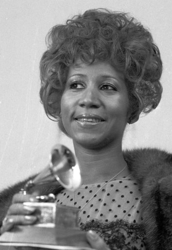 """(AP Photo/Dave Pickoff, File). FILE - In this March 13, 1972 file photo, Aretha Franklin holds her Grammy Award for Best Rhythm and Blue performance of the song """"Bridge Over Troubled Waters,"""" in New York. Franklin died Thursday, Aug. 16, 2018 at her ho..."""