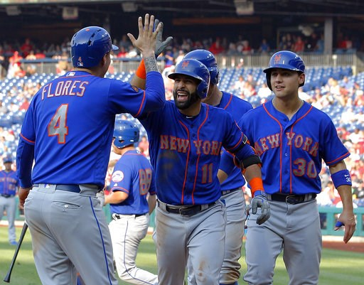 (AP Photo/Tom Mihalek). New York Mets' Jose Bautista, center, high-fives Wilmer Flores after Bautista hit a grand slam during the fifth inning of a baseball game against the Philadelphia Phillies, Thursday, Aug. 16, 2018, in Philadelphia.