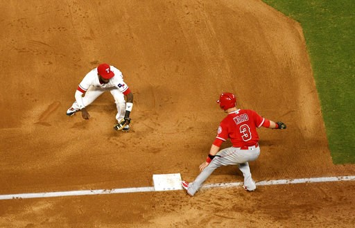 (AP Photo/Jeffrey McWhorter). Texas Rangers shortstop Jurickson Profar runs to tag out Los Angeles Angels' Taylor Ward (3) for one out of a triple play on a ground ball by David Fletcher off of Texas Rangers starting pitcher Ariel Jurado during the fou...