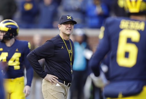 (AP Photo/Carlos Osorio, File). FILE - In this Nov. 25, 2017, file photo, Michigan coach Jim Harbaugh watches players warm up for an NCAA college football game against Ohio State in Ann Arbor, Mich. Harbaugh is 28-11 since taking over the Wolverines. T...